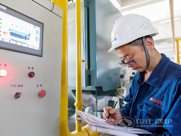 ZOZEN service personnel recorded boiler operation data on the control cabinet