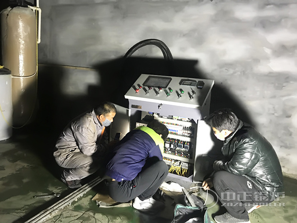 The installation staff are wiring the control cabinet