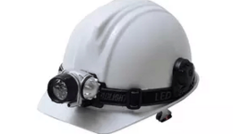 The white safety helmet and the blueprint at construction ...