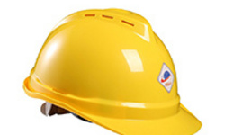 Workers wear safety helmets on a construction site in ...