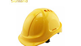 Front view of Asian factory worker with safety hard hat ...