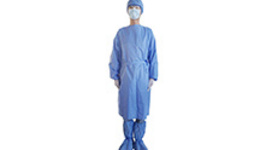 a stack of patterns of medical protective clothing lies on ...