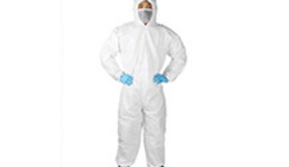 A medical staff wearing protective clothing puts a swab ...