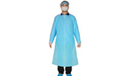 A medical staff wearing protective clothing is seen in the ...