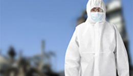 Male scientist in protective clothing working in ...